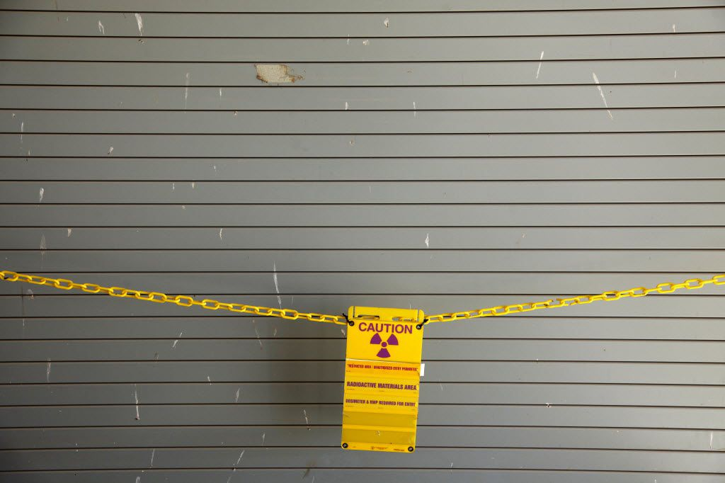 A radioactive caution signs hangs across a Container Storage Building door at Waste Control Specialists, nuclear waste facility in West Texas in 2011. (Tom Fox/The Dallas Morning News)