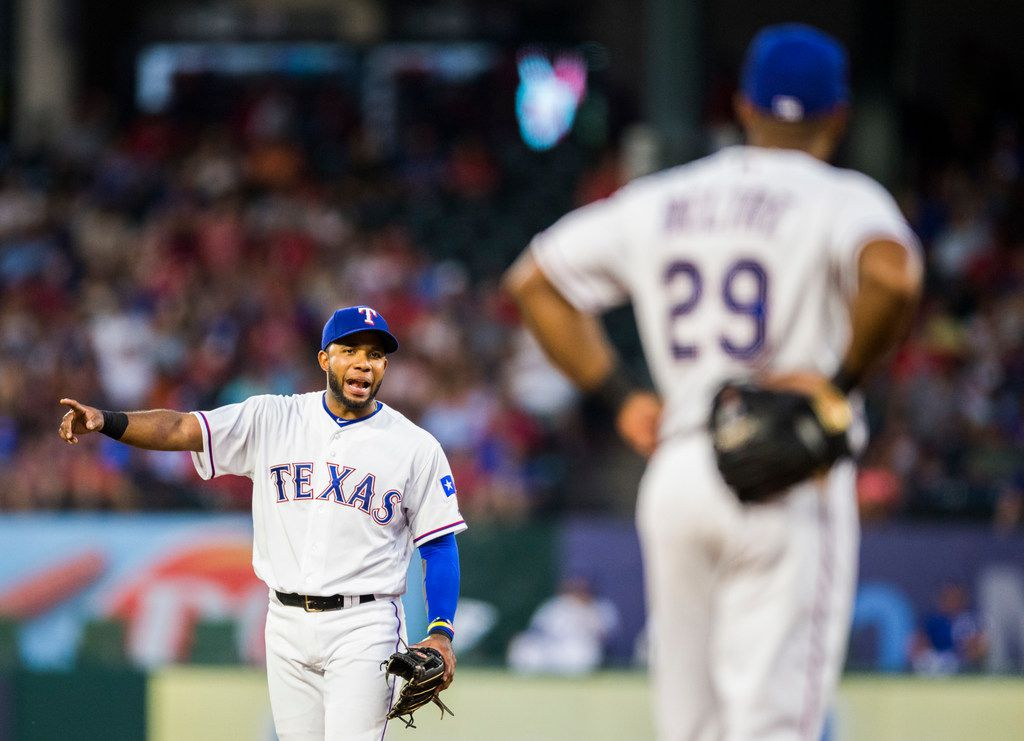 Texas Rangers shortstop Elvis Andrus (1) talks to third baseman Adrian Beltre (29) during the fifth inning of an MLB game between the Texas Rangers and the Cleveland Indians on Saturday, July 21, 2018 at Globe Life Park in Arlington, Texas. (Ashley Landis/The Dallas Morning News)