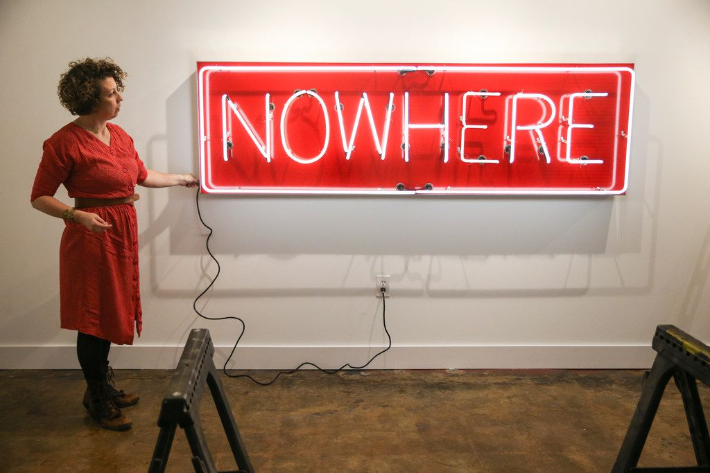 Alicia Eggert illuminates her neon sculpture NOW/HERE at the Mac in Dallas' Cedars neighborhood