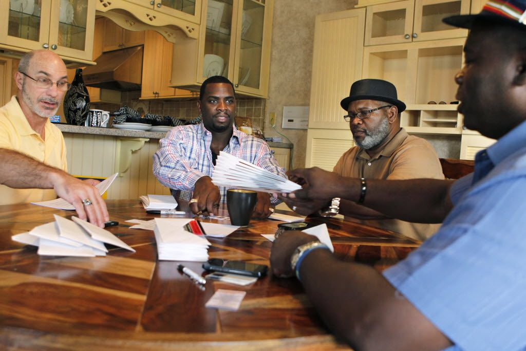 Exoneree and Director of House of Renewed Hope Christopher Scott (second from left) prepared for the organization's first fundraiser with the help of other exonerees (from left) Steven Phillips, Billy J. Smith, and Charles Allen Chatman, at his home in Carrollton in 2012.