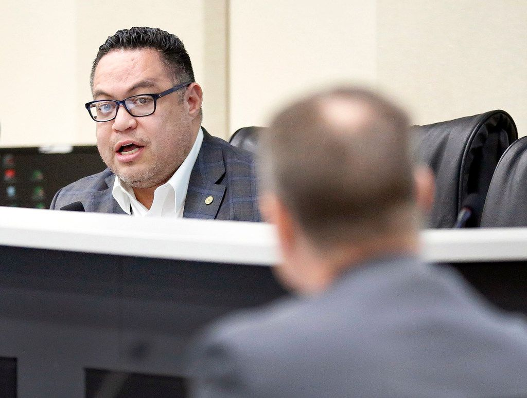 Dallas City Council member Omar Narvaez (left) addressed Assistant City Manager Jon Fortune during a council committee meeting  Monday about the city's juvenile curfew ordinance.