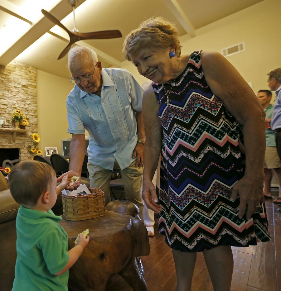 Frank and Carole Barbosa watch their 1-year-old great grand son Caleb O'Shel at their 65th wedding anniversary celebration at their daughter Ani Stone's home in Dallas, Wednesday, July 26, 2017.