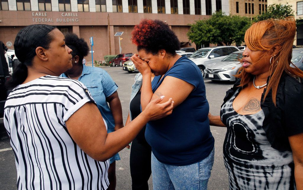 Shaquna Persley (center), mother of slain 13 yr-old Shavon Randle, is comforted by family as she leaves the Earle Cabell Federal Building in Dallas following the sentencing of Darrius Fields, Friday, May 17, 2019. Darius Fields was given an 18 year sentence by Judge Barbara Lynn on firearms charges, including the illegal possession of a weapon. He's believed to be connected to the death of Randle.