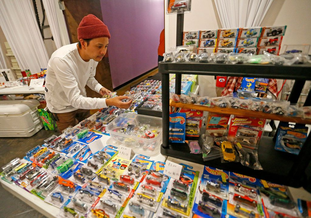 Patrick Estrella takes a close look at model cars during North Dallas Toy Show at Dallas Event Center in Farmers Branch, Texas, Saturday, Jan. 6, 2018.
