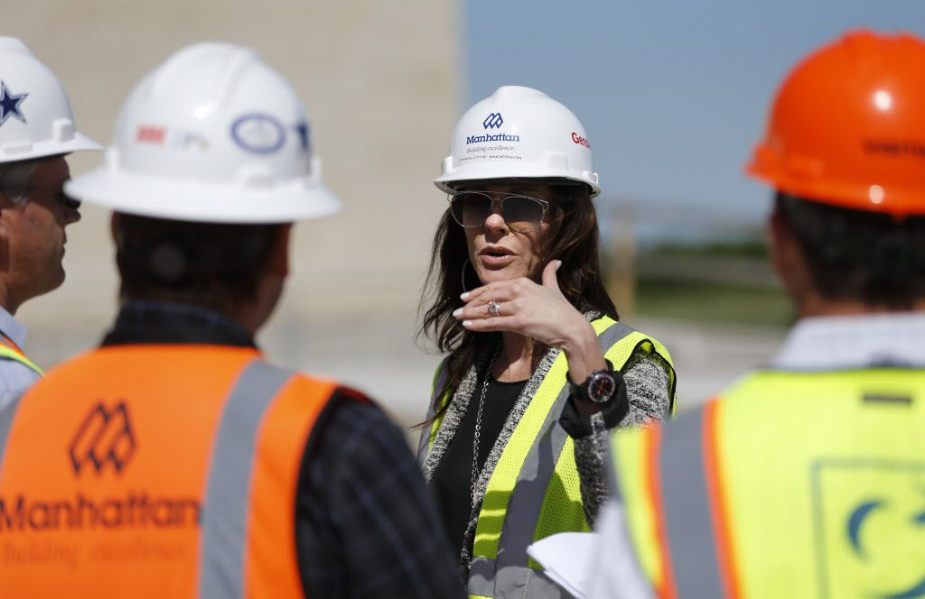 Charlotte Jones Anderson (center) Executive Vice President and Chief Brand Officer for the Dallas Cowboys talks with a team of directors and designers as they go over signs at the Dallas Cowboys new headquarters at The Star in Frisco, on Tuesday, May 3, 2016. The Star a joint project with the City of Frisco is scheduled to open in August. (Vernon Bryant/The Dallas Morning News)