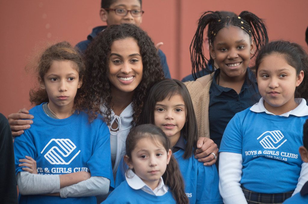 Dallas Wings basketball player Skylar Diggins-Smith posed with children from the Boys & Girls Clubs of Greater Dallas in 2017. The group held a multimillion-dollar fundraiser June 11.