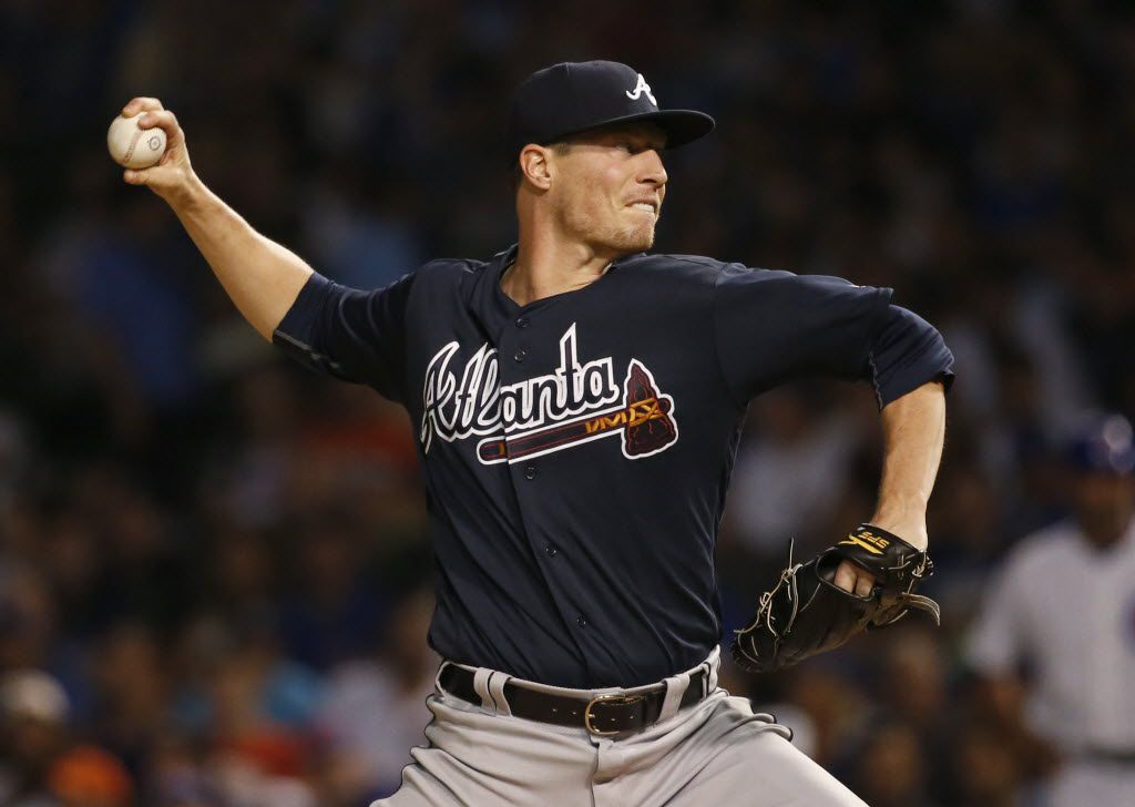 Atlanta Braves starter Lucas Harrell throws against the Chicago Cubs during the first inning of a baseball game Thursday, July 7, 2016, in Chicago. (AP Photo/Nam Y. Huh)