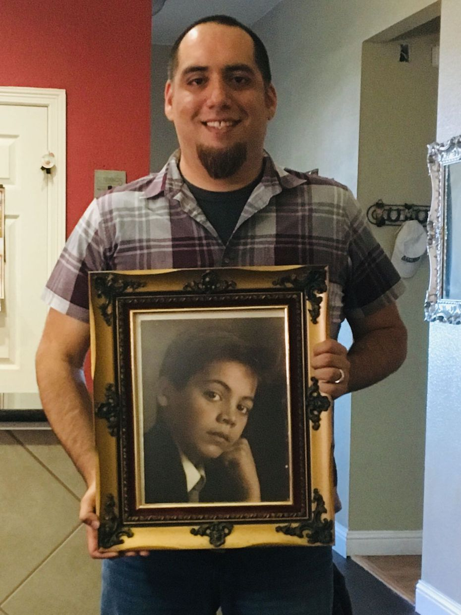 "Jamie Contreras holding a photo of Jose ""Pepe"" Villegas as a child. Contreras, a childhood friend of Villegas', reconnected with the man decades after the two lost touch."