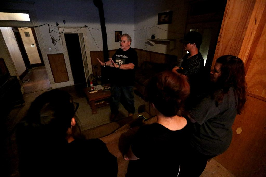 Owner Phil Kirchhoff talks to a group of people who have rented the Haunted Hill House for the night in Mineral Wells, Texas on Friday, May 12, 2017. (Rose Baca/The Dallas Morning News)