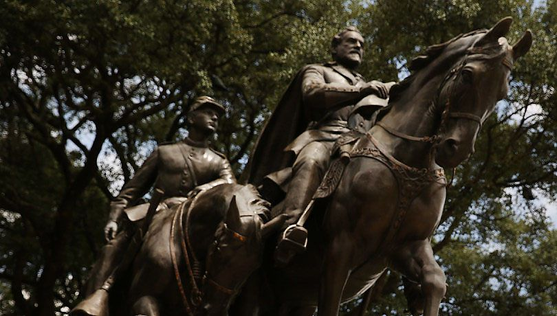 A statue of Confederate Gen. Robert E. Lee stands in the Dallas park named in his honor.