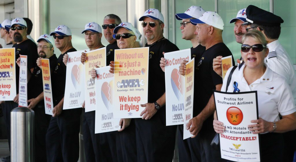 Aircraft Mechanics Fraternal Association Local 11, Southwest Airlines flight Attendants' Union and Southwest Airlines Pilots' Association picket for contract negotiations at the entrance to Love Field in Dallas on Aug. 8, 2016.