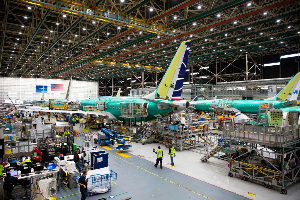 Employees work on Boeing 737 MAX airplanes at the Boeing Renton Factory in Renton, Wash., in March. Leaders at major airlines are eager to demonstrate to customers that the planes will be safe once they are recertified.
