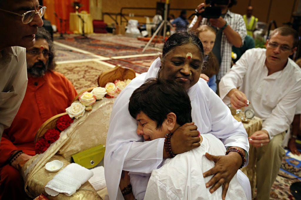 Spiritual leader and humanitarian Sri Mata Amritanandamayi Devi, center, also known as Amma, will be stopping in Denton on her nine-city tour for free public programs June 21 and 22.