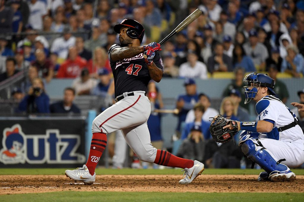 LOS ANGELES, CALIFORNIA - OCTOBER 09: Howie Kendrick #47 of the Washington Nationals hits a grand slam in the tenth inning of game five of the National League Division Series against the Los Angeles Dodgers at Dodger Stadium on October 09, 2019 in Los Angeles, California. (Photo by Harry How/Getty Images)