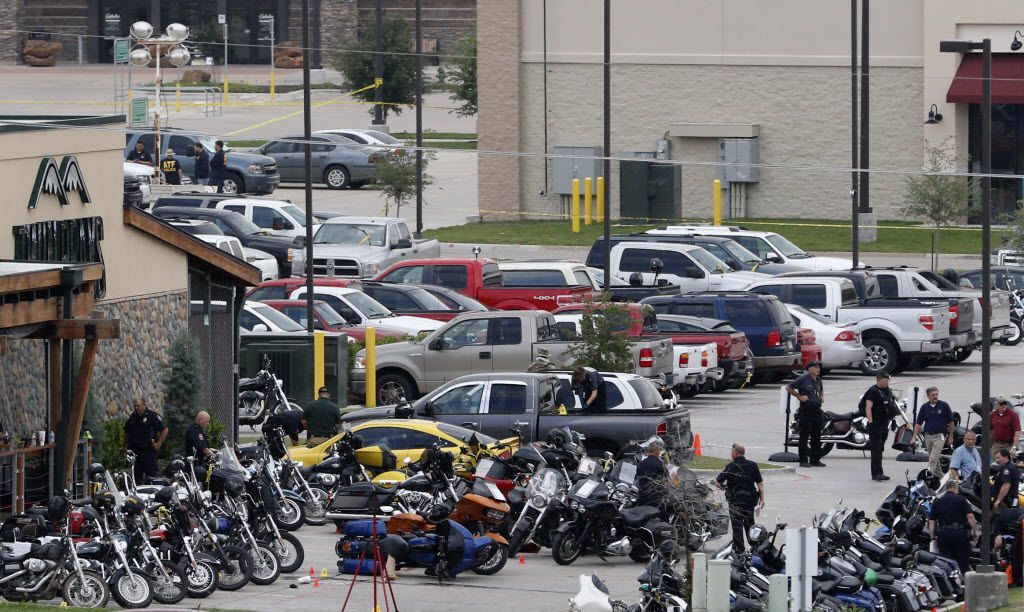 Authorities investigate the mass shooting at the Twin Peaks restaurant in Waco in this 2015 file photo. A fight between rival biker gangs broke out in the bathroom of the Twin Peaks and erupted in a shootout, leaving nine dead.