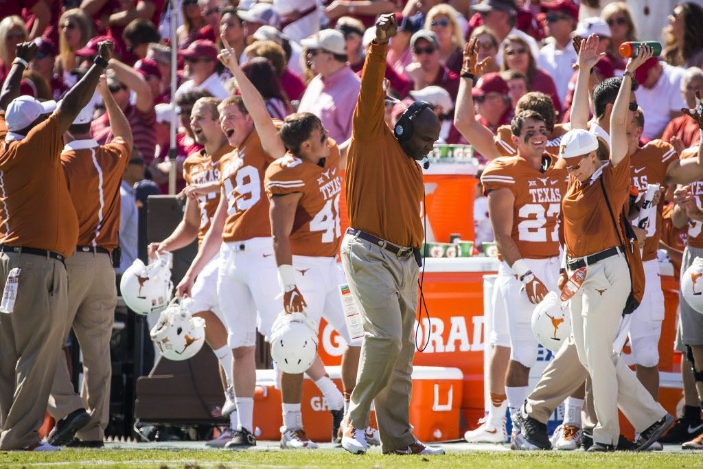Texas head coach Charlie Strong celebrates after a replay upheld a touchdown run by quarterback Tyrone Swoopes during the first half of the 2015 Red River Showdown NCAA football game against Oklahoma at the Cotton Bowl on Saturday, Oct. 10, 2015, in Dallas. (Smiley N. Pool/The Dallas Morning News)