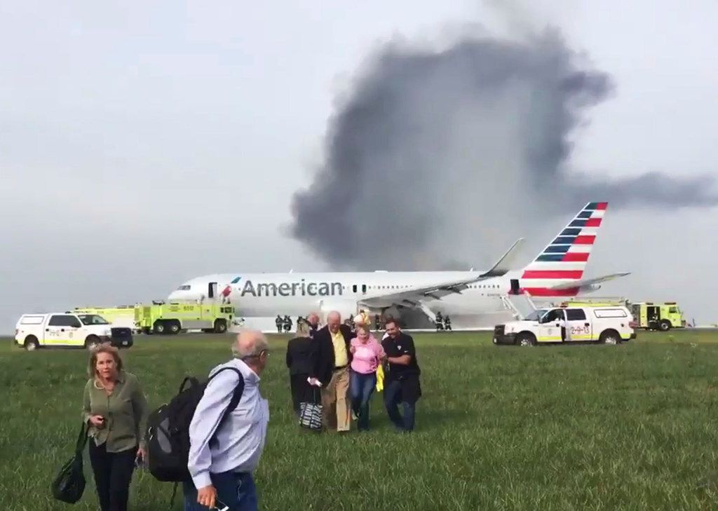 In this file photo, passengers walk away from a burning American Airlines jet that aborted takeoff and caught fire on the runaway at Chicago's O'Hare International Airport on Oct. 28, 2016.