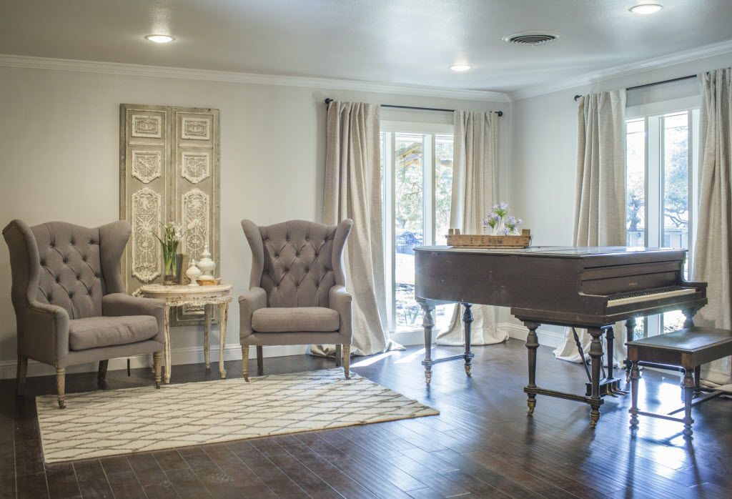 A living room redone by Chip and Joanna Gaines of HGTV s Fixer Upper As seen on Fixer Upper, the sitting room has a very elegant look with its antique piano and high backed chairs. [ 2015PUB - 2015MARCH ] 03282015xARTSLIFE