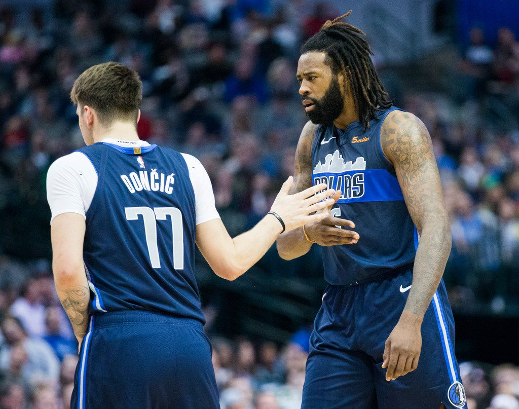 Dallas Mavericks forward Luka Doncic (77) high-fives center DeAndre Jordan (6) during the second quarter of an NBA game between the Dallas Mavericks and the Brooklyn Nets on Wednesday, November 21, 2018 at the American Airlines Center in Dallas. (Ashley Landis/The Dallas Morning News)