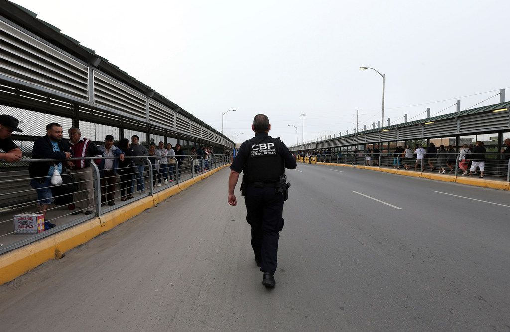 "A Customs and Border Patrol officer walks towards the middle of the Hidalgo/Reynosa International bridge before the traditional ""Abrazo"" on Friday, March 1, 2019 in Hidalgo, Texas. The city kicked off the festivities with their traditional 'Abrazo International Ceremony,' an annual event that brings leaders from the U.S. and Mexico to the Hidalgo-Reynosa International Bridge to celebrate their partnership. (Delcia Lopez/The Monitor via AP)"