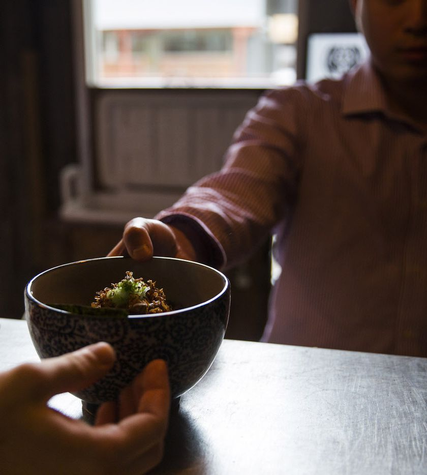 Order from the touch screen, and one of the chefs will hand your ramen over the pass.