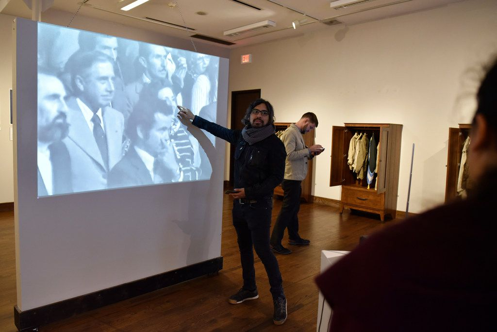 Peruvian artist Rudolph Castro speaks about a video projected on a wall at his exhibition at the Oak Cliff Cultural Center. His trip to Dallas was his first visit to the United States.