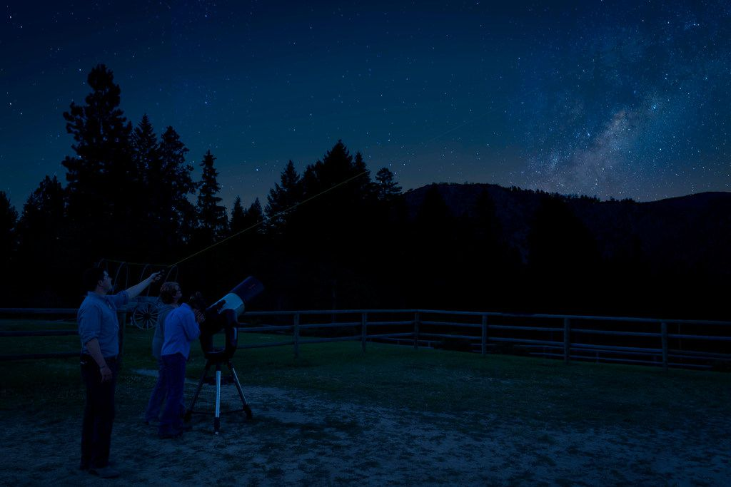 Guests at the Triple Creek Ranch find a secluded spot for stargazing, with the center of the Milky Way rising above the surrounding mountains.