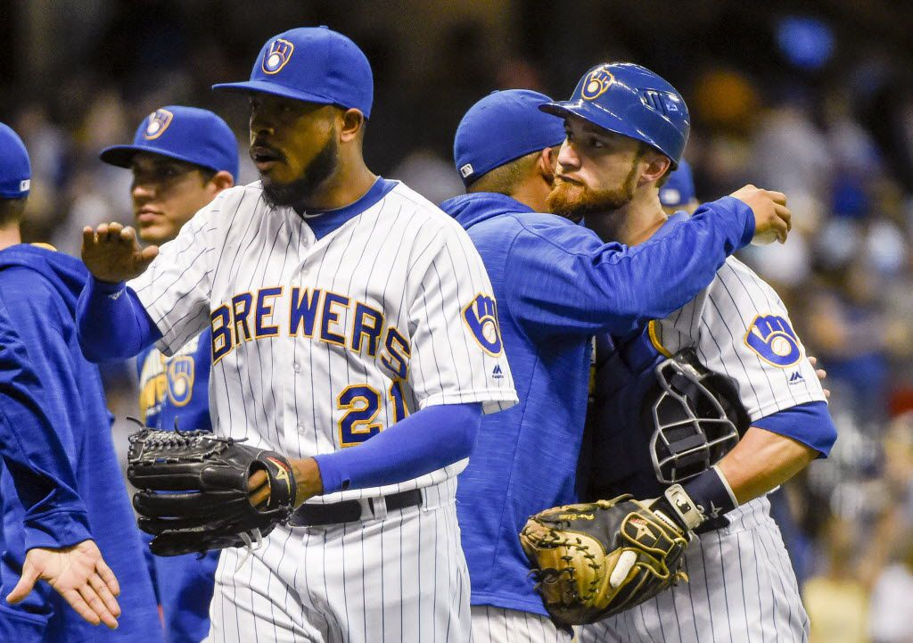 Milwaukee Brewers pitcher Jeremy Jeffress, left, and catcher Jonathan Lucroy, right, celebrate after the Brewers defeated the Pittsburgh Pirates 3-1 in a baseball game Friday, July 29, 2016, in Milwaukee. (AP Photo/Benny Sieu)