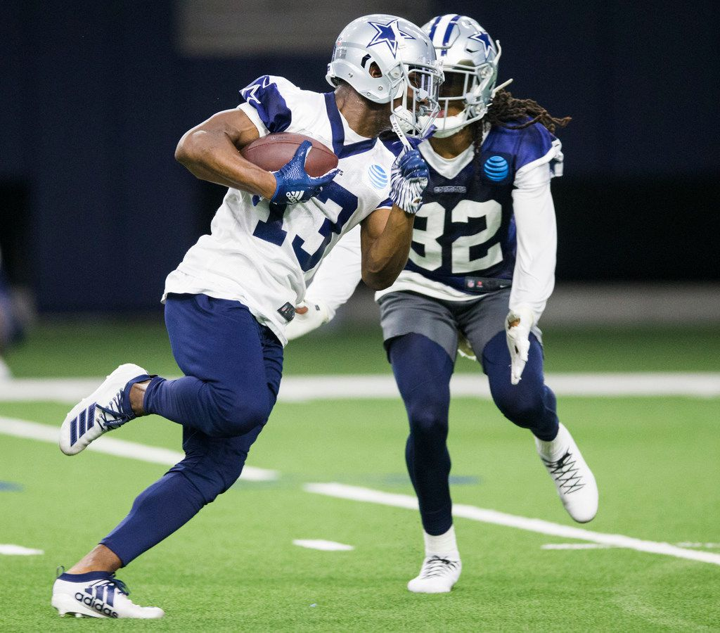 Dallas Cowboys wide receiver Michael Gallup (13) gets past cornerback Donovan Olumba (32) during a Dallas Cowboys OTA practice on Wednesday, May 29, 2019 at The Star in Frisco. (Ashley Landis/The Dallas Morning News)