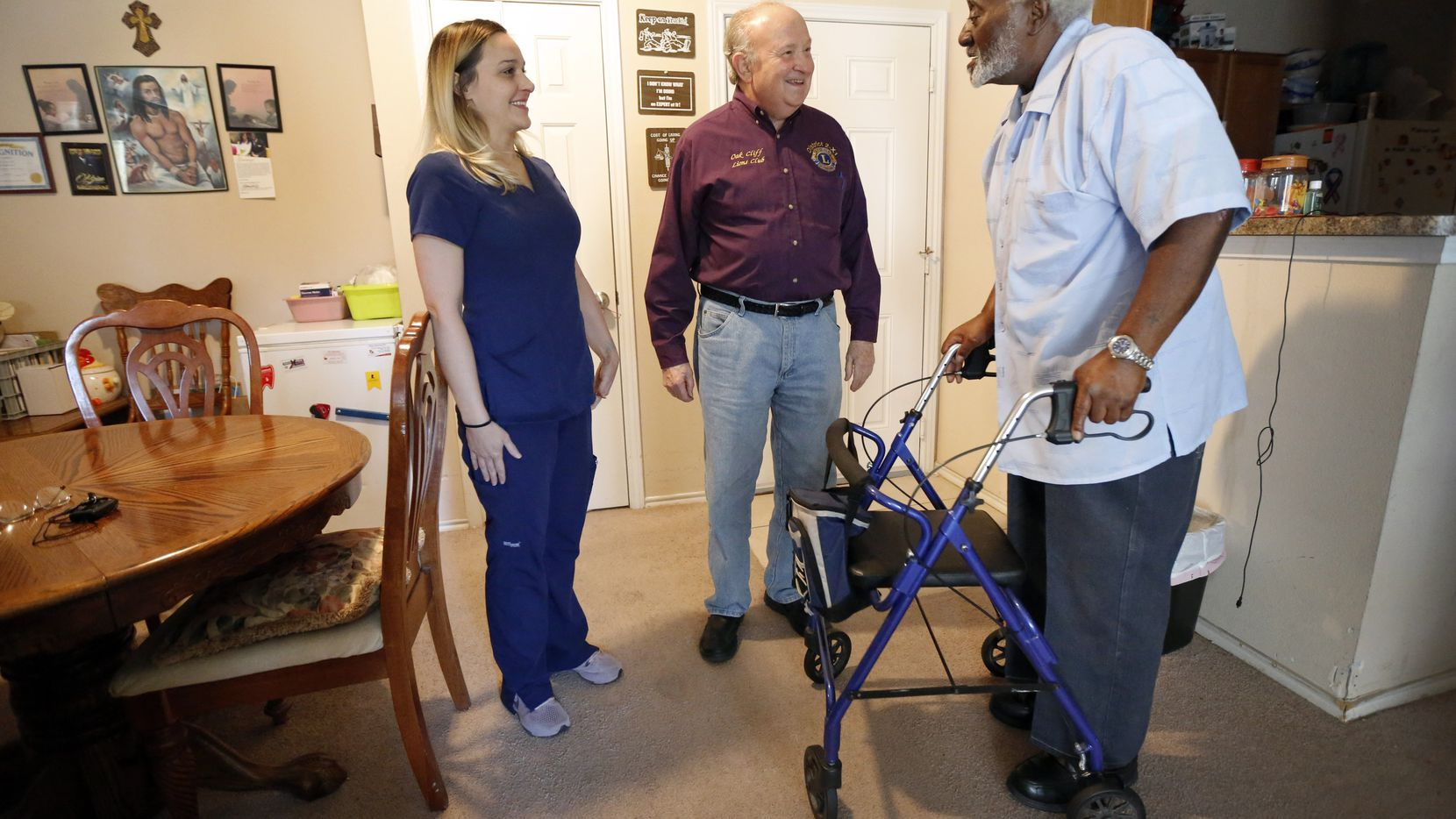 Meals on Wheels recipient George Kelley visited with Abby Tupper and her father Charlie Tupper, an Oak Cliff Lions Club member, as the three recounted how the Tuppers came to Kelley's aid.