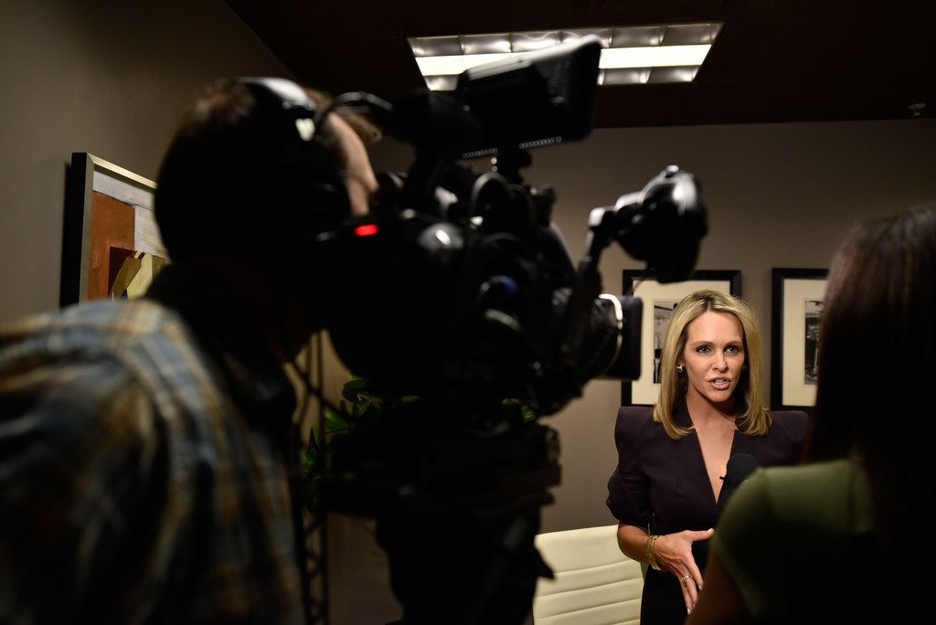 Evening news anchor Meredith Land, KXAS-TV (NBC5), is interviewed for a PSA for Giving Tuesday.