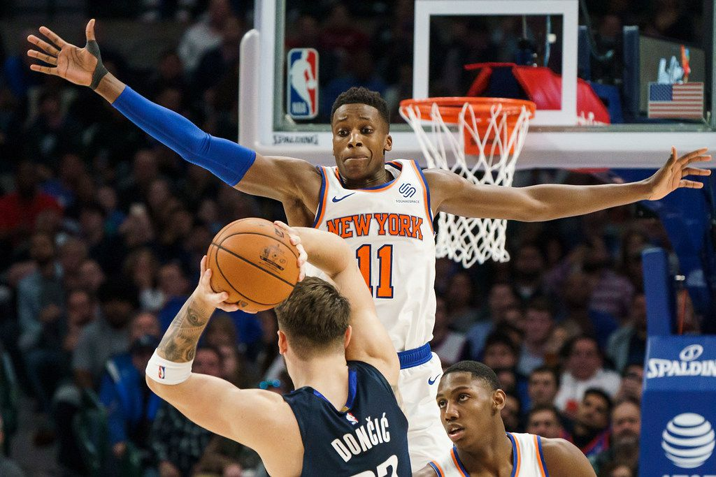 New York Knicks guard Frank Ntilikina (11) defends against Dallas Mavericks guard Luka Doncic (77) during the second half of an NBA basketball game at American Airlines Center on Friday, Nov. 8, 2019, in Dallas. (Smiley N. Pool/The Dallas Morning News)