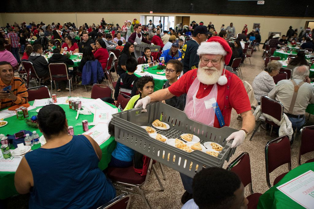 Volunteer James Dykes helps serve pie during the 29th Annual H-E-B Feast of Sharing at the American Bank Convention Center Exhibit Hall in Corpus Christi on Dec. 13.