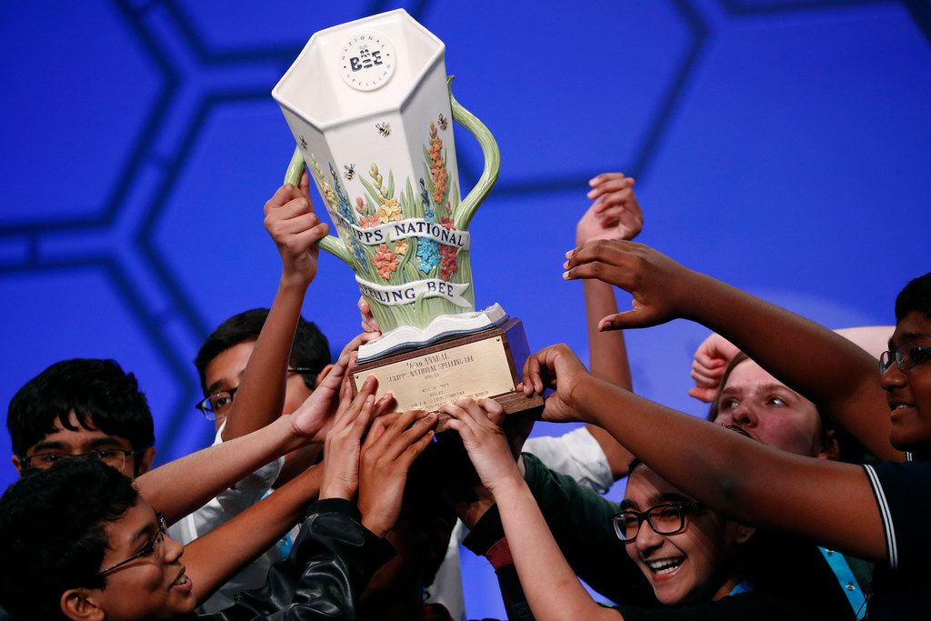 Eight co-champions celebrate after winning the Scripps National Spelling Bee, Friday, May 31, 2019, in Oxon Hill, Md. The spelling bee ended in unprecedented 8-way championship tie after organizers ran out of challenging words.  (AP Photo/Patrick Semansky)