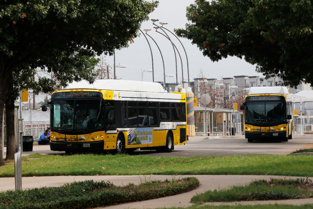 DART buses pick-up and drop off passengers at DART's Mockingbird Station on Tuesday, October 25, 2016. DART's Mockingbird Station is one of the busiest stations on DART's Dallas-area commuter rail line The 11 acres of parking are surrounded by apartments, office buildings, shopping and a hotel. DART is asking developers to come up with proposals to build high-density urban projects on the parking lots. DART wants to lease the land to builders who could put up anything from apartment towers to office or hotel high-rises on the property.  (David Woo/The Dallas Morning News)