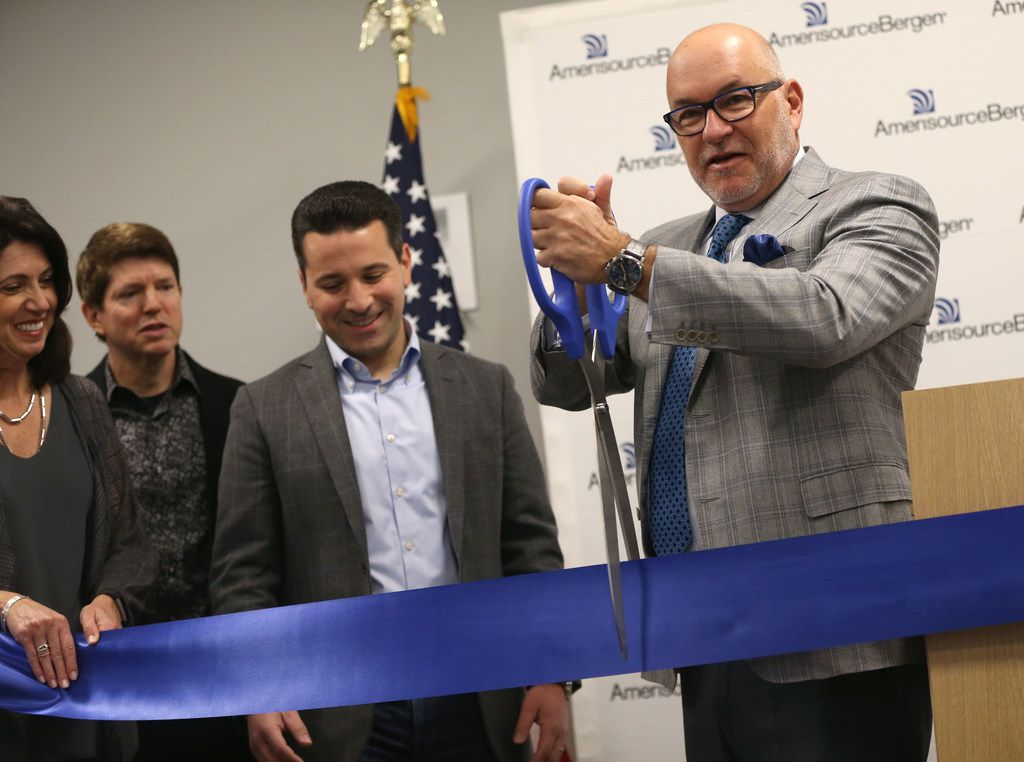Steve Collis, CEO and president of AmerisourceBergen Corporation, cuts a ceremonial ribbon at AmerisourceBergen's new campus in Carrollton, Texas on April 12, 2019. (Rose Baca/Staff Photographer)