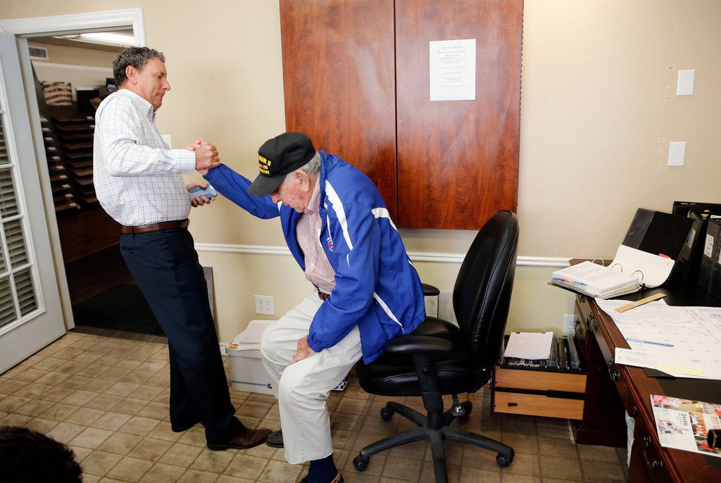 Chris Hollingsworth helps up his dad, Chester Hollingsworth, to take him to lunch.