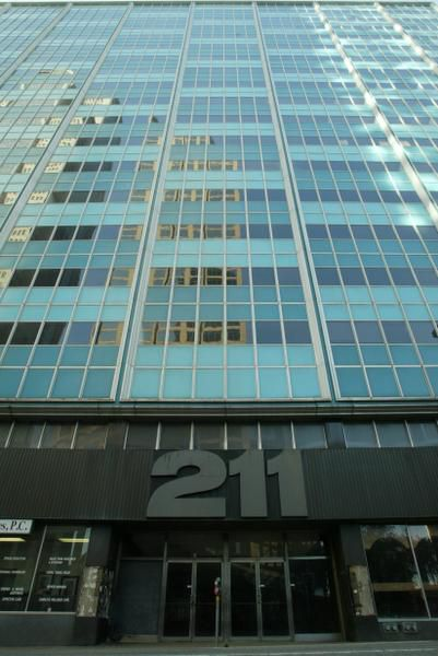 The 211 N. Ervay building, a midcentury office high-rise, has been both derided and praised for its bright blue exterior. The tower has been empty since the 1990s.