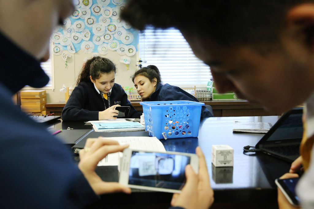 Sophomores Jessica Hernandez (left) and Stephanie Gonzalez (right) work through an elemental compounds activity with smartphones in the classroom of chemistry teacher Barbara Janicki at Cristo Rey Dallas College Preparatory School in the Pleasant Grove neighborhood of Dallas Wednesday February 22, 2017. Cristo Rey is a catholic private school within a network of 32 others school nationwide. All students who attend come from households at or below the poverty line. Students who attend work one day a week to pay toward their tuition. There is a 100% college acceptance across the network. (Andy Jacobsohn/The Dallas Morning News)