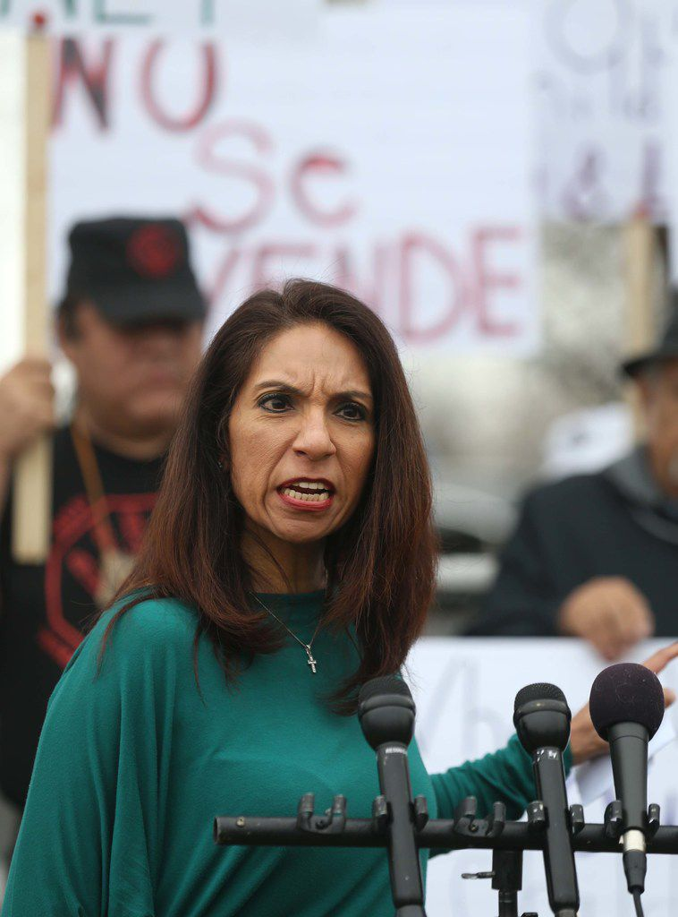Maria Lozada Garcia, president of the La Bajada Neighborhood Community Association, speaks Wednesday during a protest against the sale of the Bataan Community Center in West Dallas.