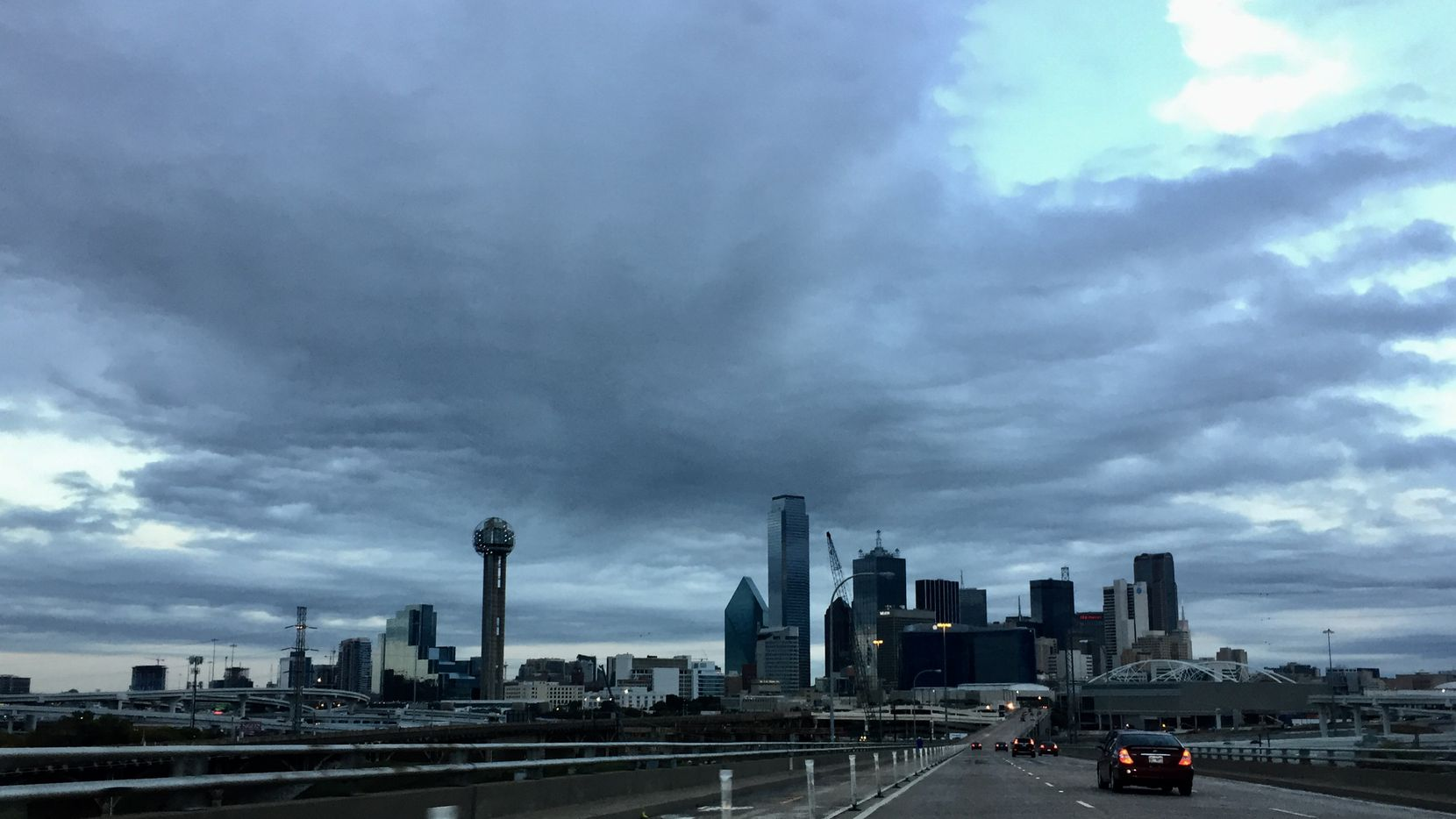Dark clouds loom over downtown Dallas as a cold front moves in Friday morning.
