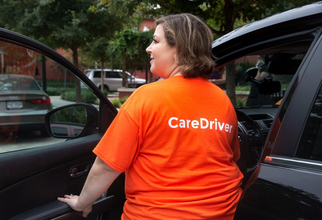 Natalie Guzman, a care driver for HopSkipDrive in Keller, Texas, poses for a portrait with her branded vehicle in Dallas on Monday, Sep. 30, 2019.