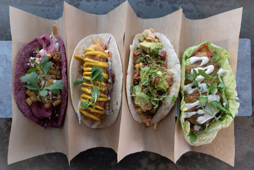 From left:  Annatto shredded pork (#8), fish n' chips (#16), slow roasted Angus brisket (#12) and  falafel (#6) at Velvet Taco  on Henderson Ave.  Photographed on Friday, August 3, 2018.   (Rex C Curry/Special Contributor)