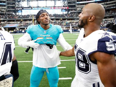 Miami Dolphins Taco Charlton (96) talks with Dallas Cowboys defensive end Robert Quinn (58) after the game at AT&T Stadium in Arlington, Texas on Sunday, September 22, 2019. The Dallas Cowboys defeated the Miami Dolphins 31-6.
