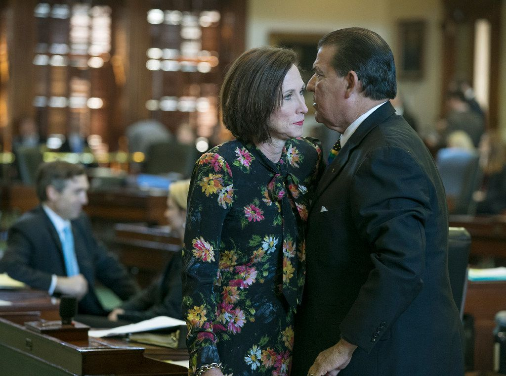 Republican state Sen. Lois Kolkhorst, author of Senate Bill 6, prohibiting transgender-friendly bathrooms, speaks with Democratic state Sen. Eddie Lucio, Jr., who has said he will endorse the legislation, as she presents the bill on the floor of the senate for debate at the state capitol in Austin, Texas. At this point, Lucio is the only Democrat supporting the bill. (Ralph Barrera/Austin American-Statesman via AP)