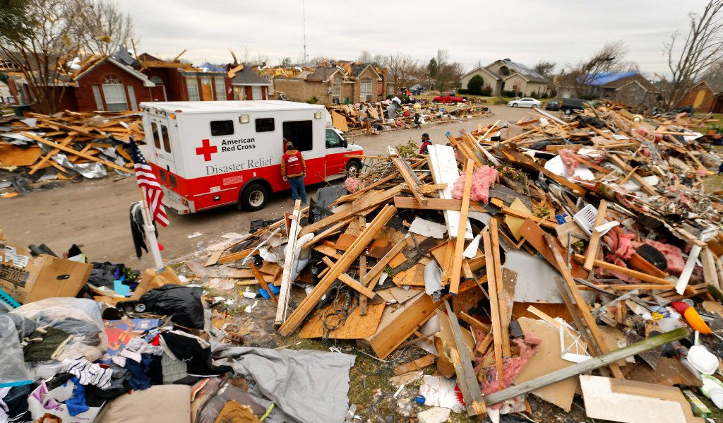 An American Red Cross Disaster Relief truck stops between the mounds of debris lining Crestpoint Lane in Garland, Texas as tornado cleanup continues, Wednesday, January 6, 2016. (Tom Fox/The Dallas Morning News) ORG XMIT: DMN1601061816313180