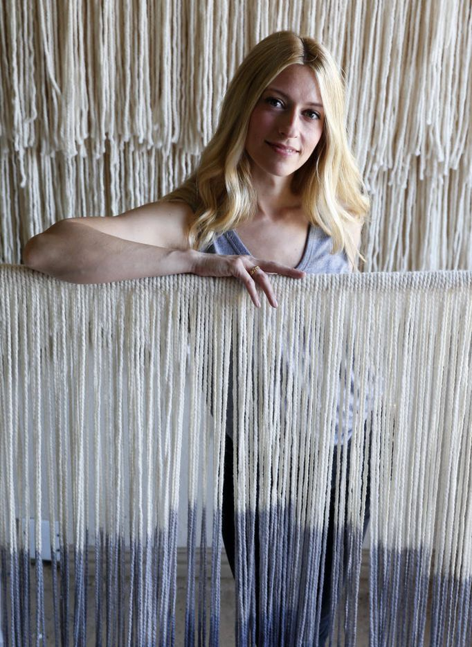 Artist Lauren Williams poses for a portrait next to a tapestry she made at her home in Frisco, on Wednesday, April 27, 2016. Williams makes modern bohemian fiber art for clients. (Vernon Bryant/The Dallas Morning News)