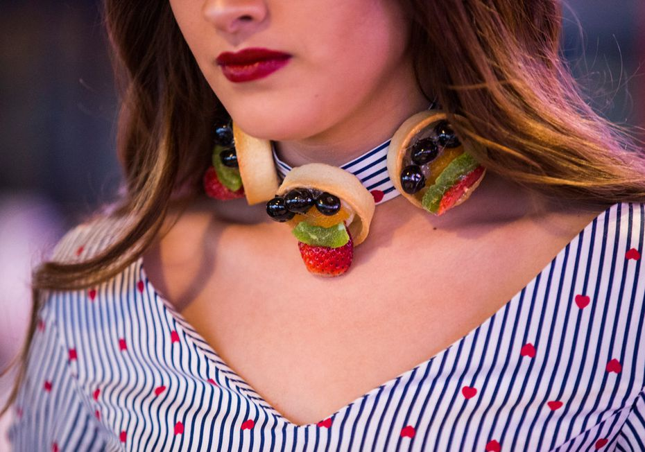 Model Aneida Gonzalez wears a choker decorated with fruit tarts from La Madeleine at Food in Fashion.