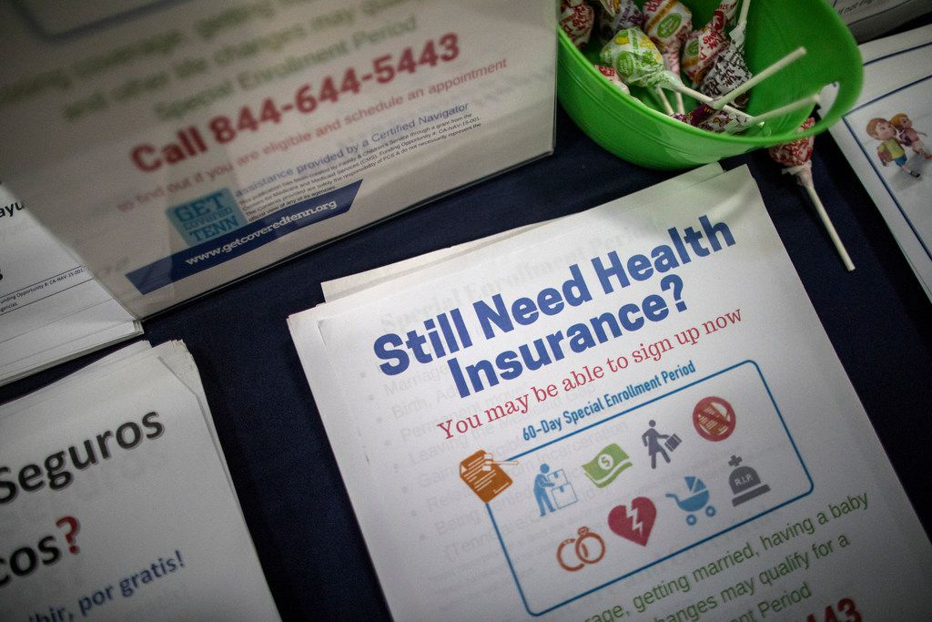 FILE — Enrollment counselor Sharon Barker's booth at a back-to-school event at the Martha O'Bryan Center in Nashville, Tenn., Aug. 4, 2017. A federal judge in Texas struck down the Affordable Care Act in December 2018, a day before the deadline to sign up for next year's coverage in most states, but you might still have time to enroll depending on where you live. (Joe Buglewicz/The New York Times)
