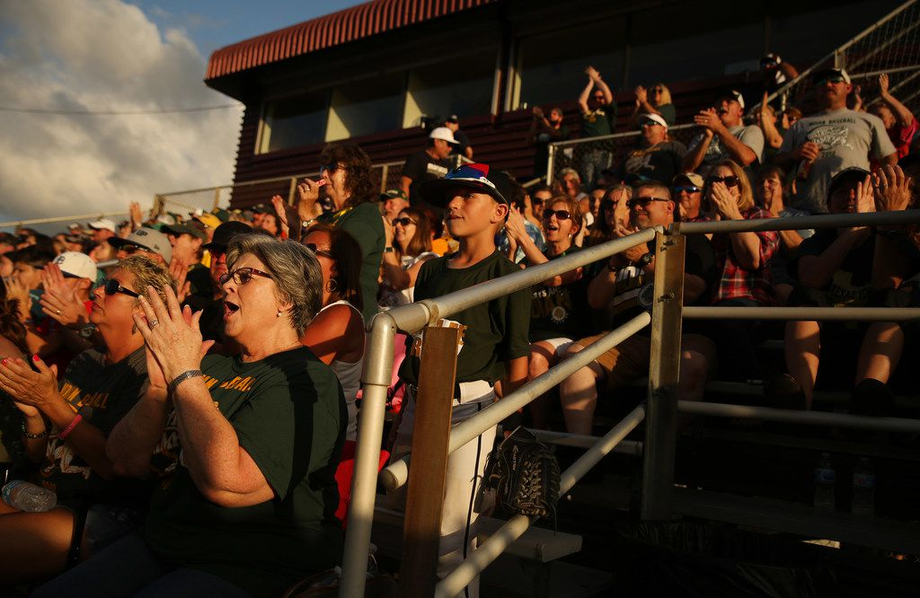 Mickie May, the grandmother of Santa Fe catcher Josh Blankenship, cheers during the second game of the best-of-three series in the Class 5A Region III playoff high school baseball game between Santa Fe and Kingwood Park at Jim Kethan Field at Deer Park High School in Deer Park, TX Saturday May 19, 2018. On Friday morning, 10 people were killed and 13 were injured after a shooting at Santa Fe High School. The game was postponed to Saturday after it was scheduled for Friday. Dimitrios Pagourtzis was booked into the Galveston County Jail on capital murder charges.
